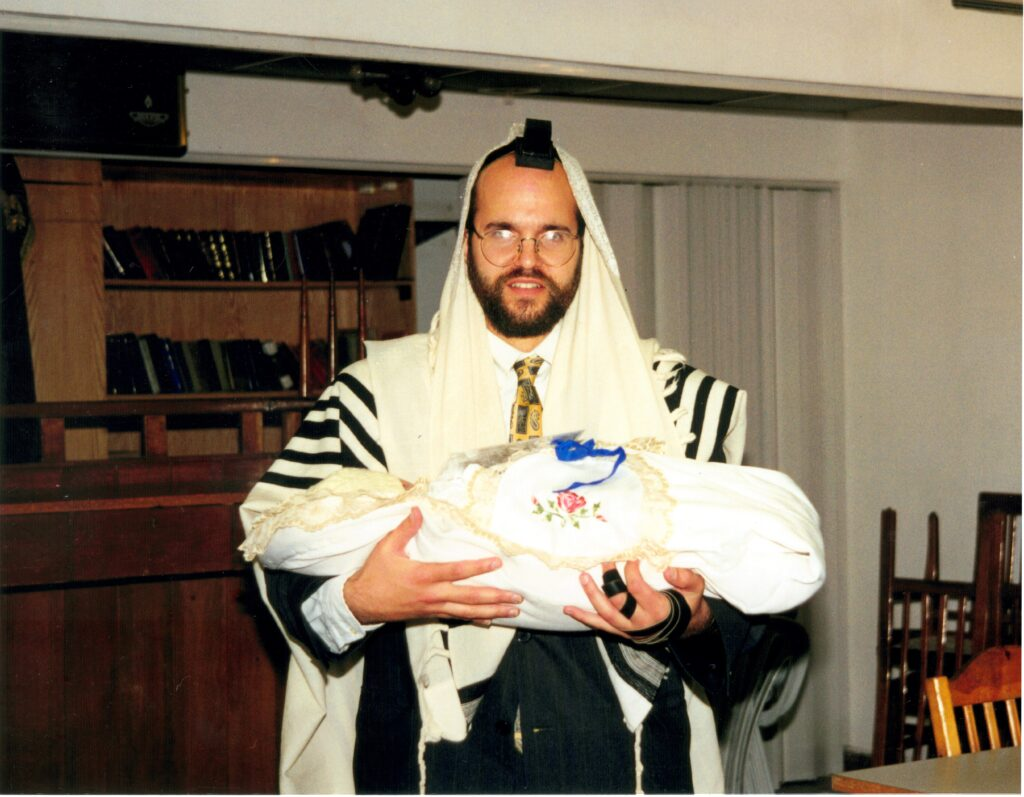 Holding YItzchak Meir before his bris