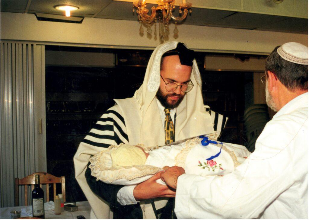 Holding Yitzchak Meir - with the hospital's Mohel