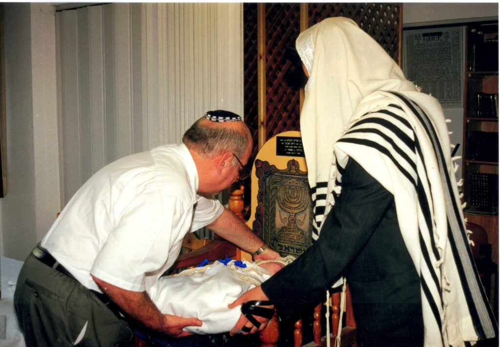 """Father-in-Law putting Yitzchak Meir on the """"Kisei Shel Eliyahu"""" - the chair of Elijah the Prophet"""
